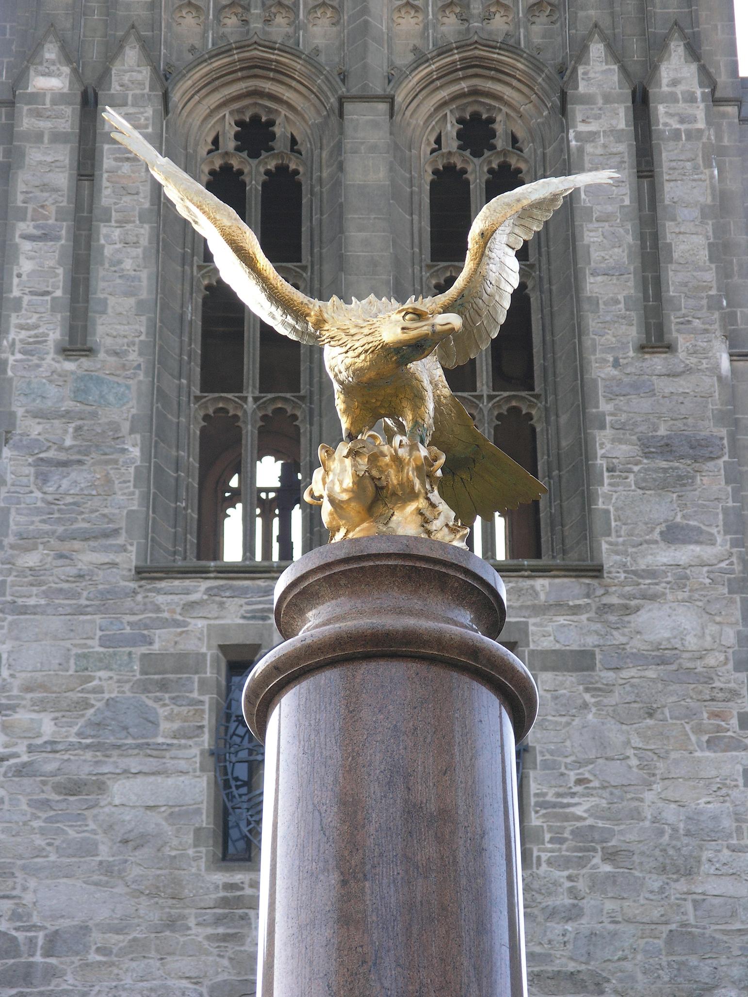 Photograph showing golden eagle on marble pedestal