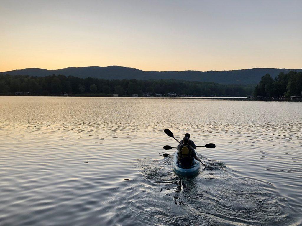 Andrew Gapinski and Kang Wang canoe on Lake Cherokee