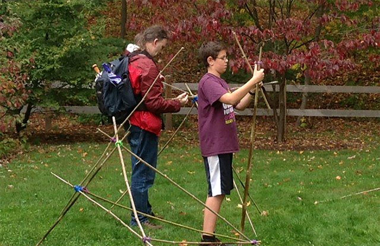 Teens using engineering kits