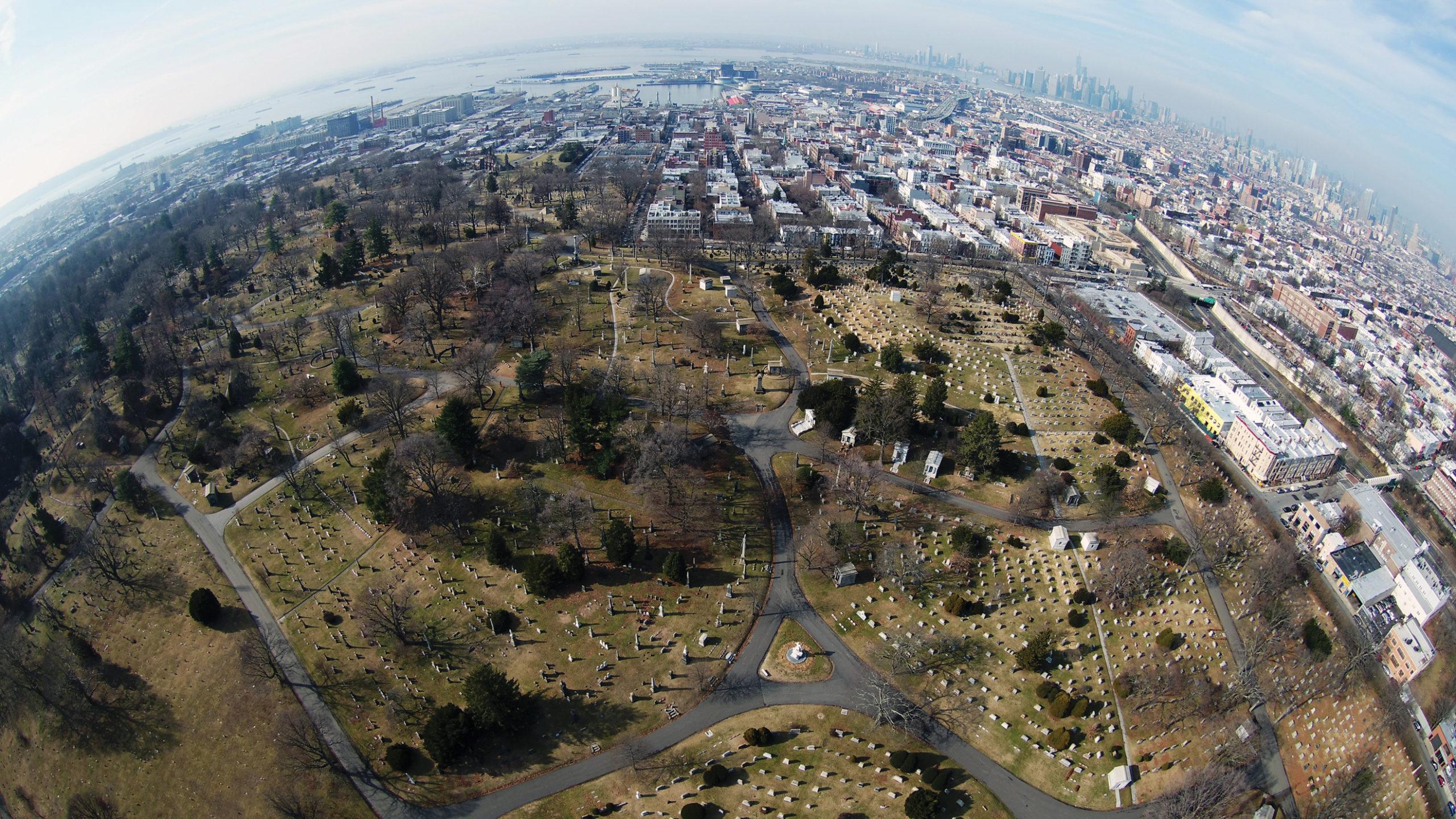 Aerial photograph of cemetery with Manhattan skyline on horizon