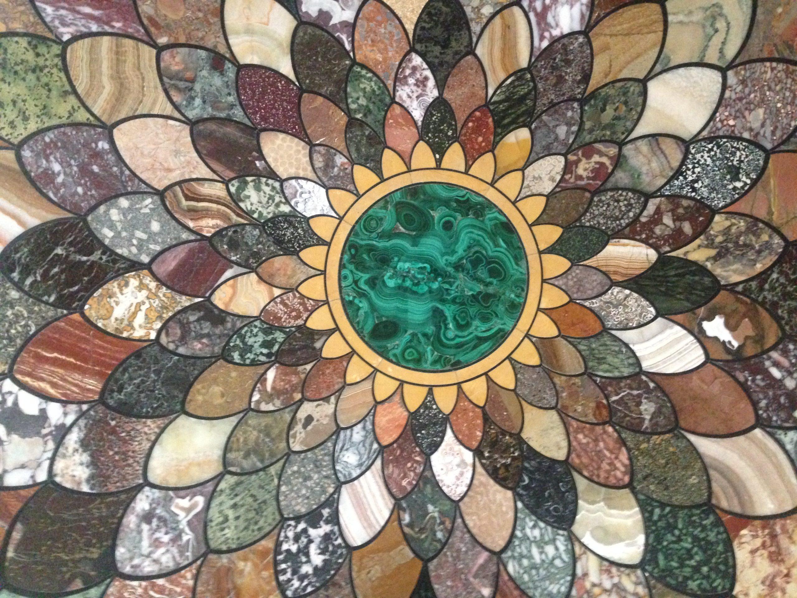 Tabletop inlaid with semi-precious stones.