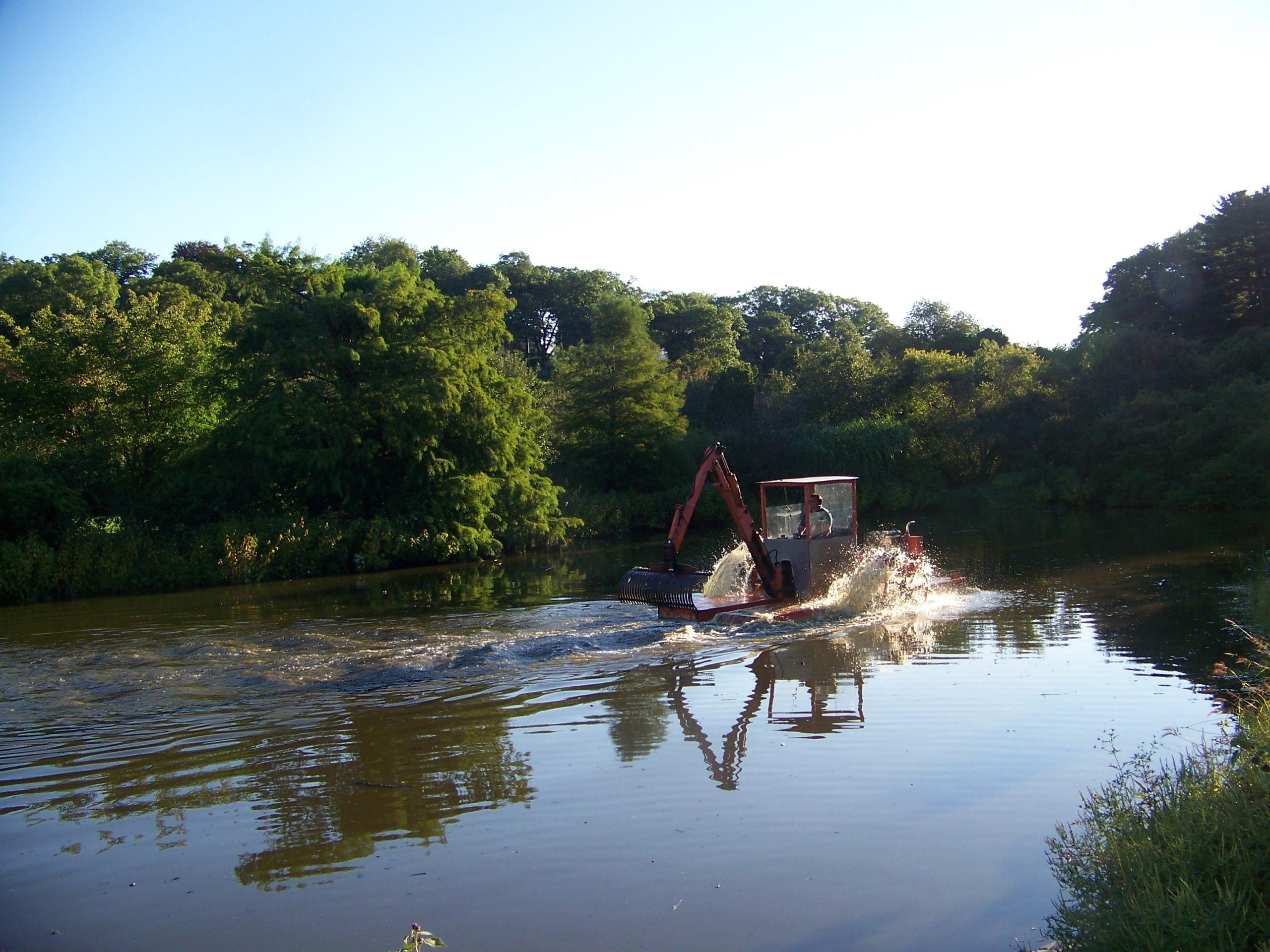Hydro-raking Dawson Pond.