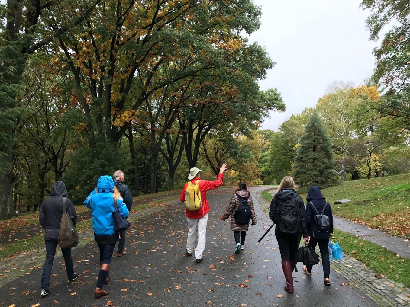 Volunteer leading tour through the landscape