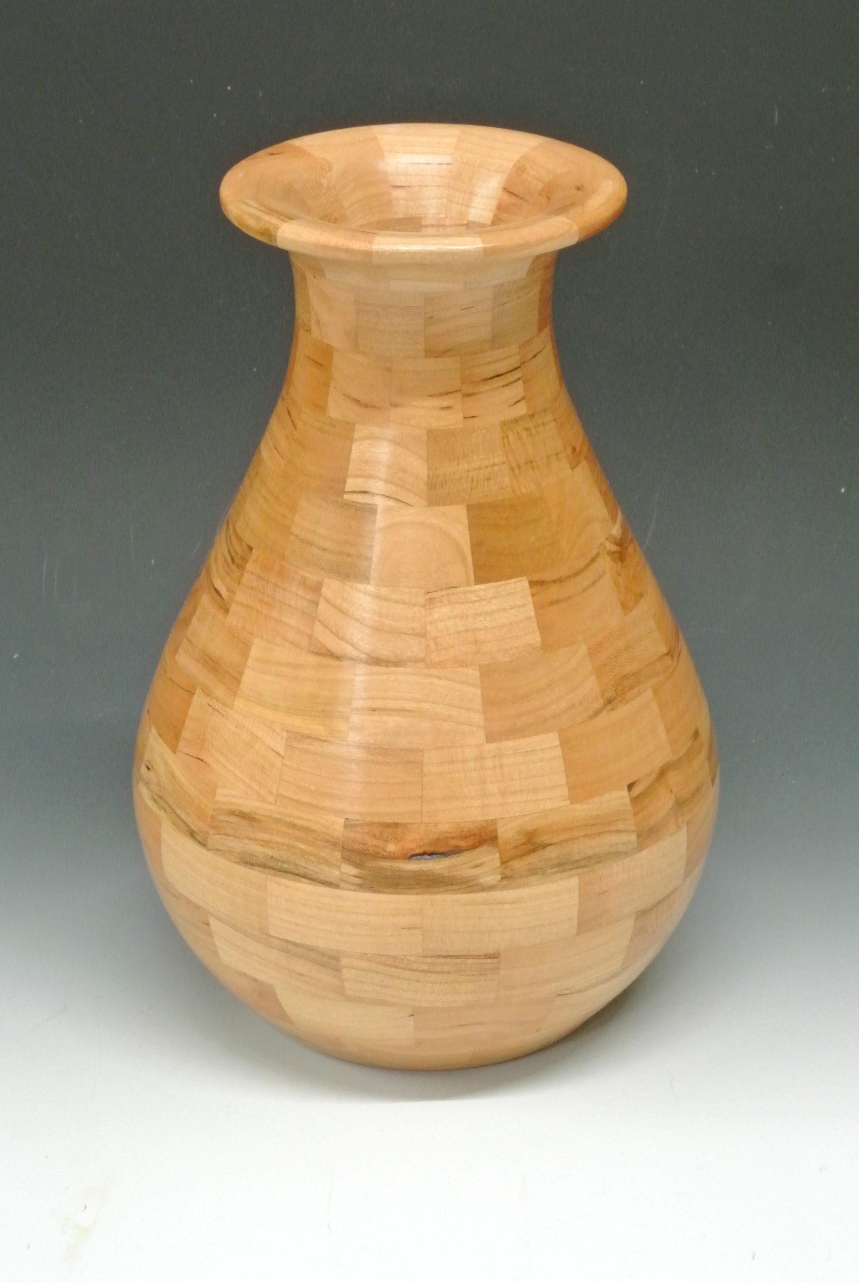 Turned wood, symetrical vase